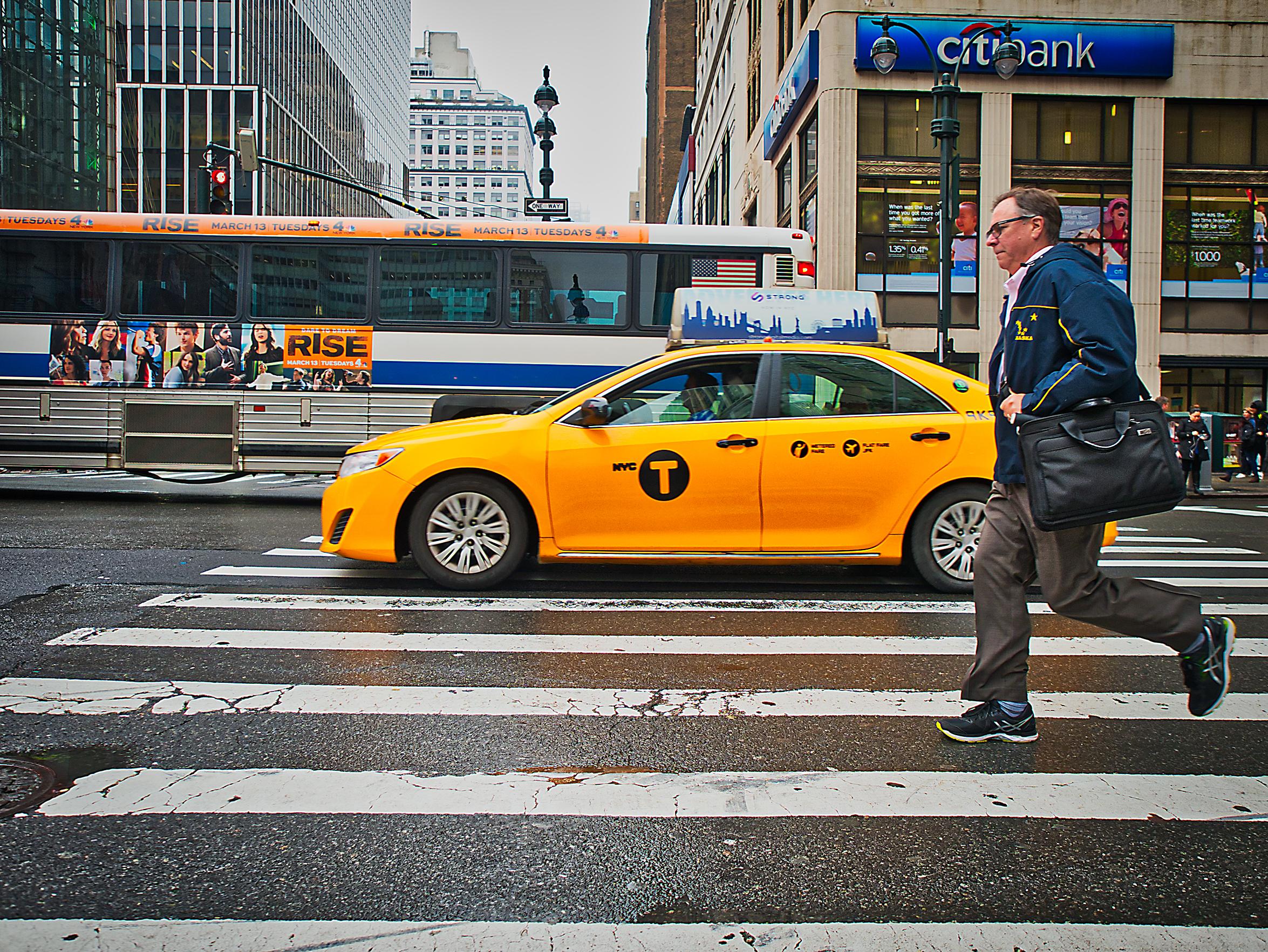 man in crosswalk